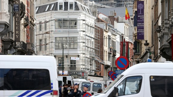 Caption:Policemen close the access of the scene of a shooting near the Jewish Museum in Brussels, on May 24, 2014. Three people were killed and one badly injured in a shoot-out Saturday near the Jewish Museum in Brussels city centre, Belga news agency said, quoting firefighters