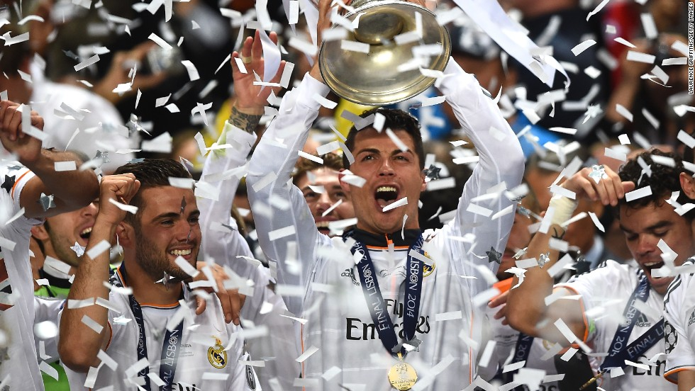 Cristiano Ronaldo of Real Madrid lifts the Champions League trophy after the team's  4-1 victory over Atletico on May 24 in Lisbon, Portugal.