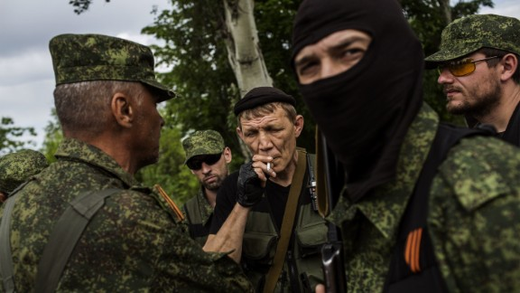A Pro-Russian militant smokes a cigarette during a briefing at a check-point on the road between Donetsk and Mariupol, eastern Ukraine, on May 25, 2014.