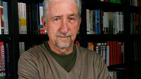 Author Tom Hayden poses before signing copies of his book,
