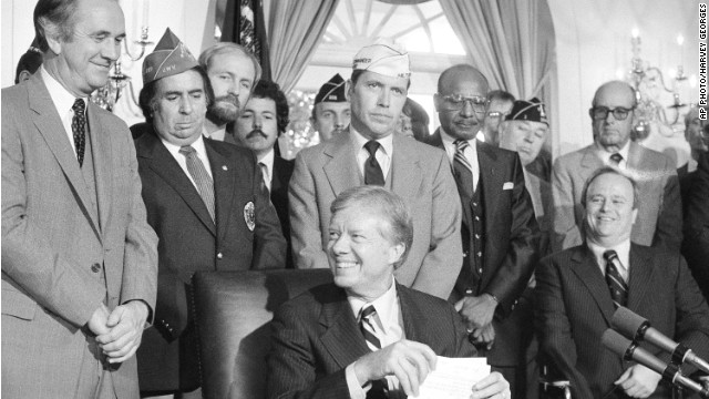 President Jimmy Carter after signing the 1980 Veterans Rehabilitation and Education Amendment, which increased job training and educational benefits for vets.