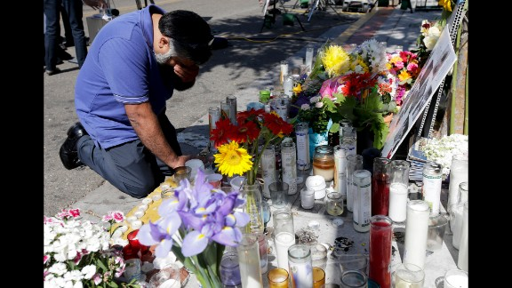 Jose Cardoso pays his respects Sunday, May 25, at a makeshift memorial at the IV Deli Mart, where part of a mass shooting took place, in Isla Vista, California. Elliot Rodger, 22, went on a rampage Friday night, May 23, near the University of California, Santa Barbara, stabbing three people to death at his apartment before shooting and killing three more in a nearby neighborhood, sheriff