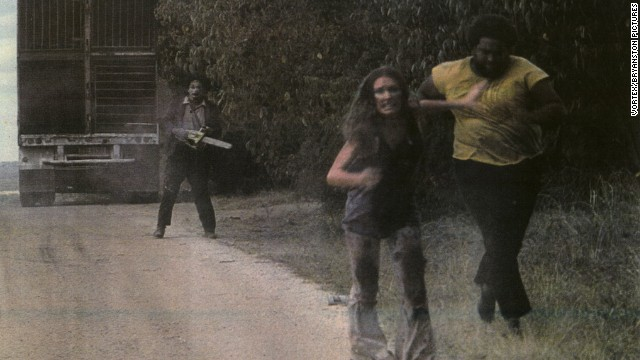 "Marilyn Burns (center) runs from ""Leatherface"" in 'The Texas Chainsaw Massacre' (1974)."