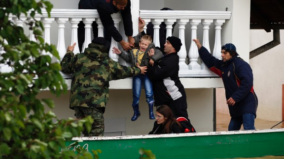 Serbian soldiers rescue a boy from a flooded house in Obrenovac on May 17.