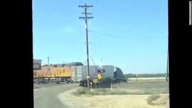 Semi-truck gets stuck on tracks, then