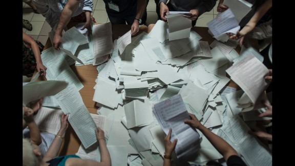Election commission officials count ballots at a polling station in Kiev on Sunday, May 25.