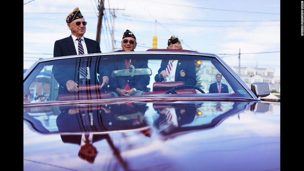 Korean War veterans participate in a Memorial Day parade in Fairfield, Connecticut, on May 26, 2014.
