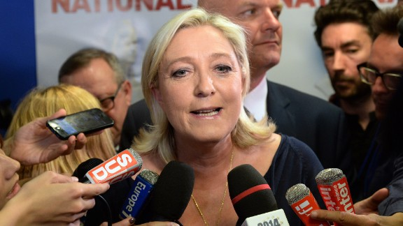 French far-right Front National (FN) party president Marine Le Pen reacts at the party's headquarters in Nanterre, outside Paris, on May 25, 2014.