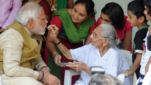 The image said to have moved Sharif's mother: Modi's mother feeding him sweets on May 16, 2014.