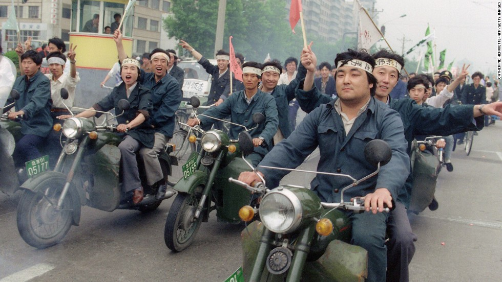 May 18, 1989, Chinese workers parade on motorbikes in support of student hunger strikers.