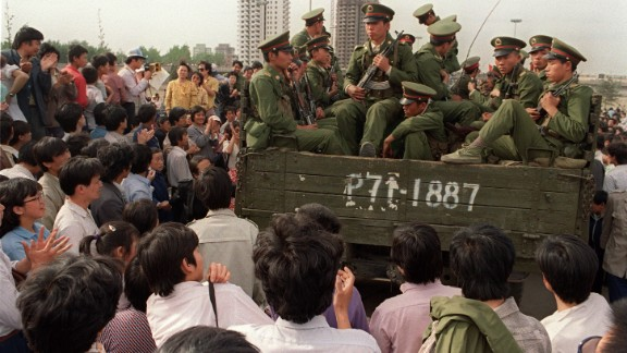 Pro-democracy demonstrators surround a truck filled of People's Liberation Army (PLA) soldiers on 20 May 1989 in Beijing on their way to Tiananmen Square.