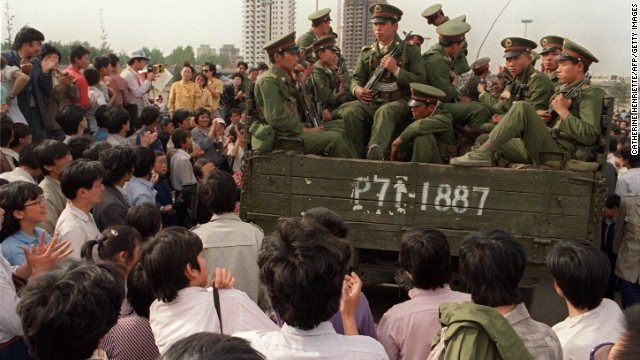 MAY 21: Pro-democracy demonstrators surround a truck filled of People's Liberation Army (PLO) soldiers 20 May 1989 in Beijing on their way to Tiananmen Square 20 May 1989 after the Martial Law was proclaimed in Beijing 20 May. In a show of force, 04 June, China leaders vented their fury and frustration on student dissidents and their pro-democracy supporters. Several hundred people have been killed and thousands wounded when soldiers moved on Tiananmen Square during a violent military crackdown ending six weeks of student demonstrations. (Photo credit should read CATHERINE HENRIETTE/AFP/Getty Images)