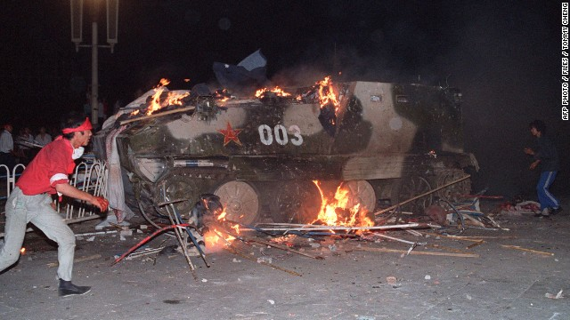 This file photo taken on June 4, 1989 shows an armoured personnel carrier in flames as students set it on fire near Tiananmen Square in Beijing. Hundreds, possibly thousands, of protesters were killed by China's military on June 3 and 4, 1989, as communist leaders ordered an end to six weeks of unprecedented democracy protests in the heart of the Chinese capital. Dissidents and human rights advocates around the world will mark on June 4, 2009 the twentieth anniversary of China's bloody crackdown on the pro-democracy protests. AFP PHOTO / FILES / TOMMY CHENG