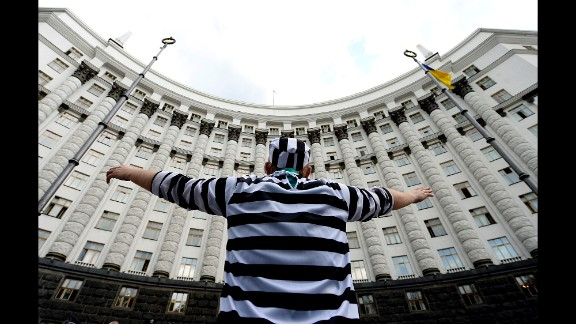 A man dressed in a prisoner costume takes part in a protest against government corruption May 27 in Kiev.