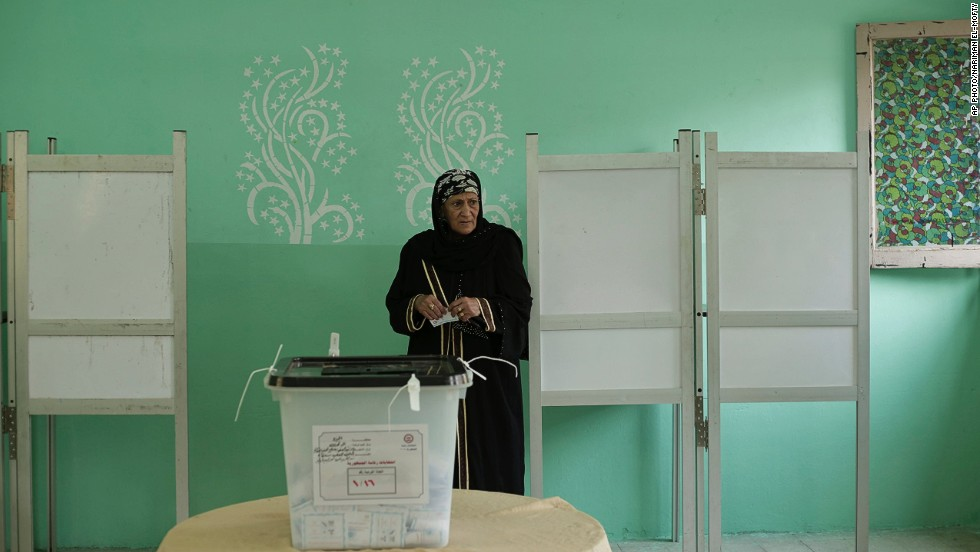 "MAY 27 - CAIRO, EGYPT: An Egyptian woman holds her ballot before casting it during the first day of the presidential election on May 26. <a href=""http://cnn.com/2014/05/23/world/africa/egypt-presidential-election-explainer/index.html"">Egyptians are voting again </a>after former President Mohamed Morsy was ousted last year. For full coverage of the Egyptian election in Arabic, visit <a href=""http://arabic.cnn.com/?hpt=ed_Arabic"">CNN Arabic.</a>"