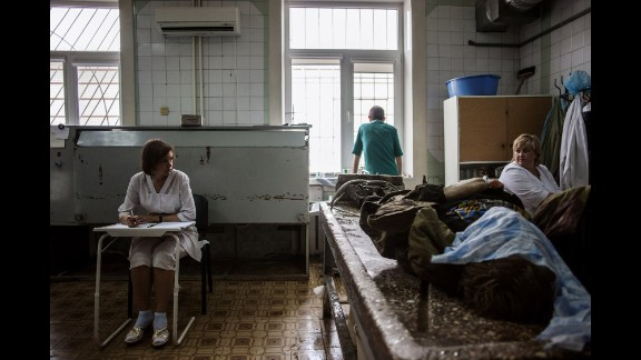 Medical staff prepare to clean the body of a pro-Russian militant at the Kalinina morgue in Donetsk on May 27.