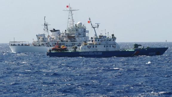 A Chinese coast guard ship (back) shadows a Vietnamese coast guard vessel near the Paracel Islands on May 14.