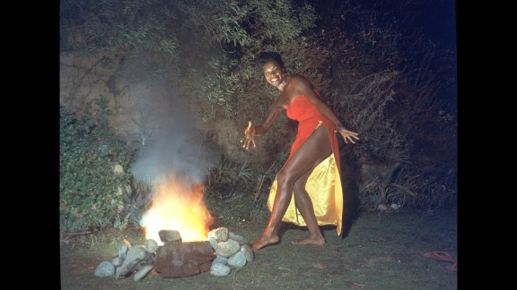 """Angelou was also a professor, singer and dancer whose work spanned several generations. Here, she dances next to a fire in this promotional portrait taken for the cover of her first album, """"Miss Calypso,"""" in 1957."""