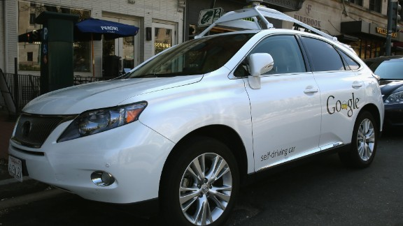 Google has logged over 300,000 miles testing driverless cars around the United States. Pictured here is its Lexus RX 450H self-driving car parked on a street in Washington, D.C., in April 2014.