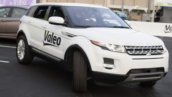 A Range Rover Evoque equipped with Valeo self-parking technology backs into a parking spot during a driverless car demo at the International Consumer Electronics Show (CES) in January.