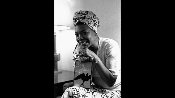 """Angelou poses with her book """"I Know Why the Caged Bird Sings"""" in 1971. It was the first in a series of autobiographical books."""
