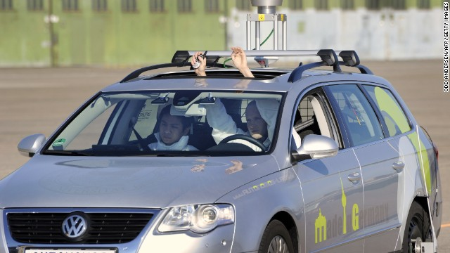 The driverless car 'Made in Germany' (MIG), which from the outside looks like a regular Volkswagen Passat with a camera on top, is being put through its paces at Berlin's disused Tempelhof airport, October 13, 2010. German scientists unveiled the latest self-driving car, a phenomenon that its proponents say will sharply reduce accidents, help the environment and transform cities. The car, dubbed the 'MIG' by its engineers at Berlin's Free University (FU), uses cameras, laser scanners and satellite navigation to 'see' other vehicles and pedestrians and deal with traffic situations. AFP PHOTO / ODD ANDERSEN (Photo credit should read ODD ANDERSEN/AFP/Getty Images)