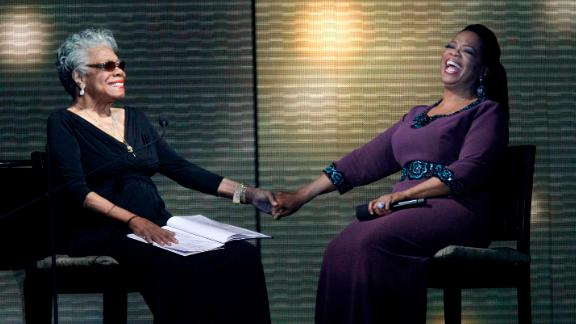 """Angelou and talk show host Oprah Winfrey laugh during the taping of """"Surprise Oprah! A Farewell Spectacular"""" in 2011."""