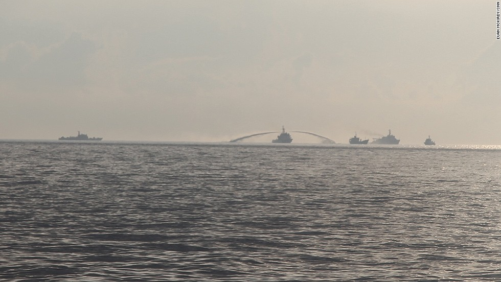 An image taken from a Vietnamese Coast Guard vessel shows a Chinese Coast Guard ship firing a water cannon at a Vietnamese fisheries research ship in disputed waters in the South China Sea on May 28.