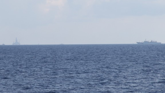 A Chinese Coast Guard ship screens a controversial oil platform drilling off the disputed Paracel Islands on May 28.