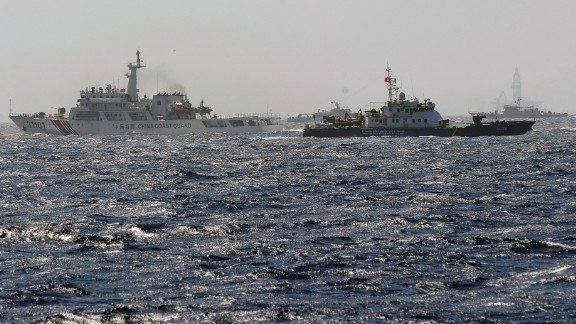 A Vietnamese Coast Guard ship (second right, dark blue) tries to make way amongst several China Coast Guard ships near a Chinese drilling oil rig (right background) being installed in disputed waters in the South China Sea on May 14.