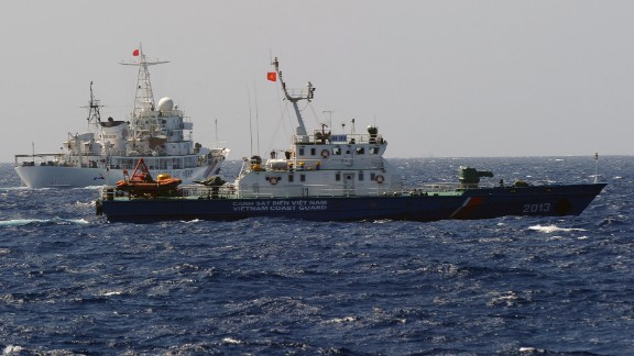 A China Coast Guard ship (left) follows a Vietnamese Coast Guard vessel (right) near the site of the oil rig on May 14.