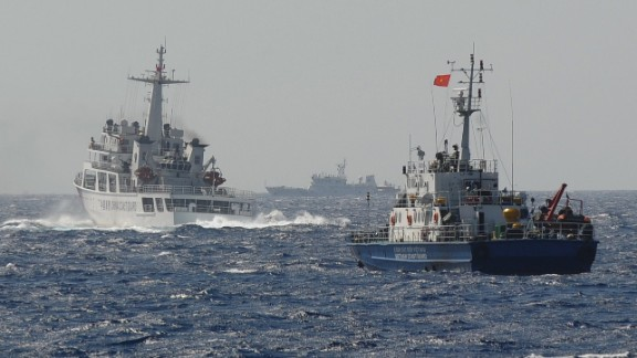 A Chinese Coast Guard vessel (left) appears to block a Vietnamese ship (right) near the area of China's oil drilling rig in disputed waters in the South China Sea on May 14.