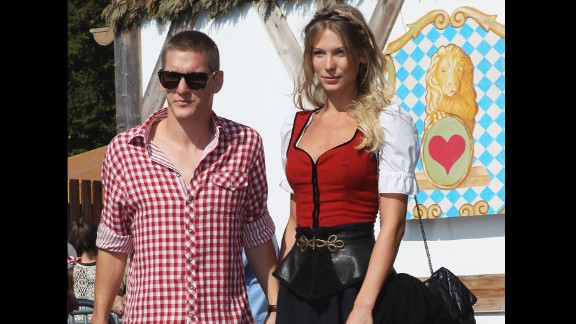 At almost 6ft, model Sarah Brandner towers above German footballer Bastian Schweinsteiger. She left little to the imagination in a revealing body painting issue of Sports Illustrated in 2010.
