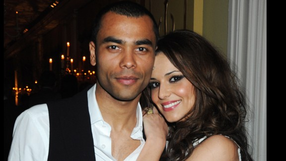 """British """"X-Factor"""" judge Cheryl Fernandez-Versini made headlines as then-girlfriend (and later wife) of England player Ashley Cole during the 2006 World Cup. """"These WAGs were out buying beautiful clothes, they all looked stunning, they"""