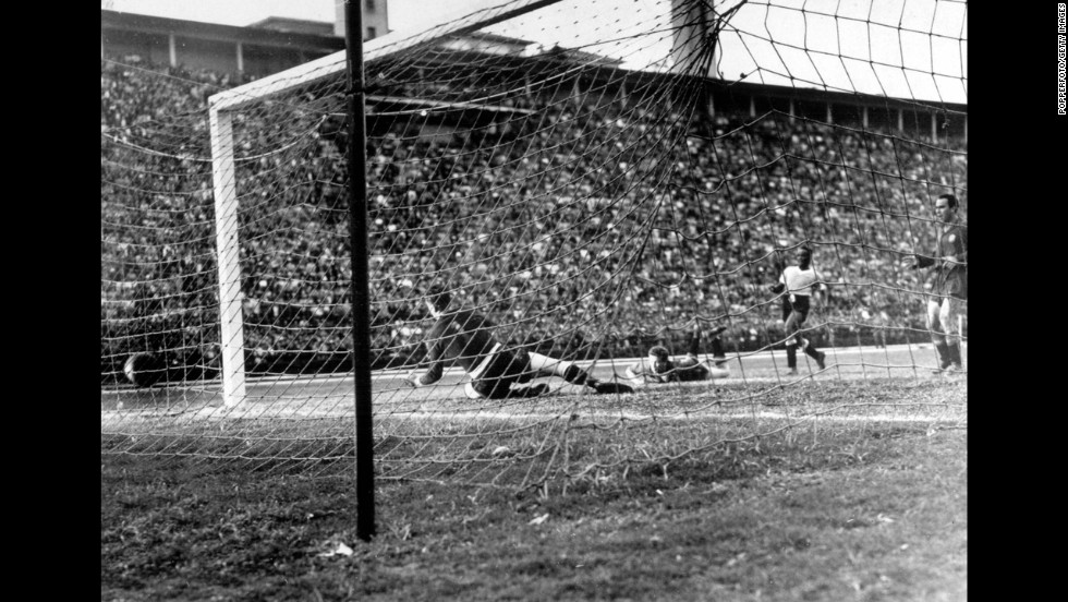 A Ghiggia shot gets past Spanish goalkeeper Antoni Ramallets during a 2-2 draw in Sao Paulo, Brazil. Four teams advanced to the final round of the tournament, which was decided by round-robin group play instead of a series of elimination games.