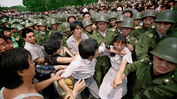 """I'm not an activist. I'm not a hero,"" Widener said in 2014. ""But I'm human, and it is hard not to be sympathetic towards anybody who was killed."" Here, a young woman is caught between civilians and Chinese soldiers who were trying to remove her from an assembly near the Great Hall of the People on June 3, 1989. ""I never actually saw any protesters killed,"" Widener said. ""I saw soldiers killed. Mistakes were made on both sides. It's important to look at both sides of the story."""