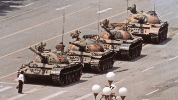 "A day after the Chinese military opened fire on protesters in 1989, photographer Jeff Widener was on the sixth-floor balcony of the Beijing Hotel. He was aiming his camera at a row of tanks when the iconic ""Tank Man"" entered the frame. ""The guy walks out with this shopping bag, and I was thinking,"