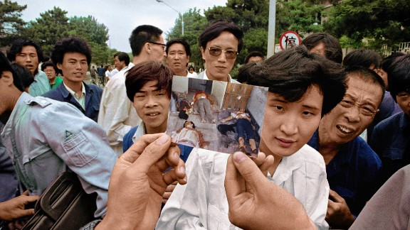 After the crackdown, people show a picture of protesters