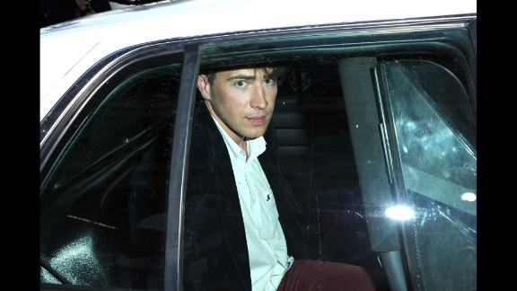"""Vitalii Sediuk sits in the back of a police car after allegedly striking Brad Pitt in the face as Pitt and Angelina Jolie walked the red carpet at the premiere of Disney's """"Maleficent"""" in Hollywood, California, on Wednesday, May 28. Sediuk has a history of confronting celebrities at red carpet events."""