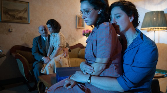 The play uses elaborate moving sets to show the Frank family's flight from their comfortable life into a cramped secret annex shared with others.