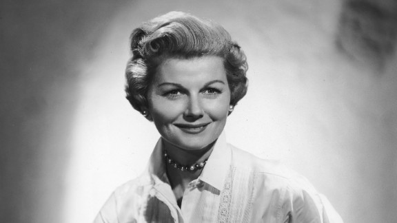 """Barbara Billingsley wears pearls and a white blouse with lace stitching, her usual attire as mother and housewife June Cleaver in the 1950s show """"Leave it to Beaver."""" Female characters in '60s TV moved beyond big skirts and heels into more adventurous territory."""