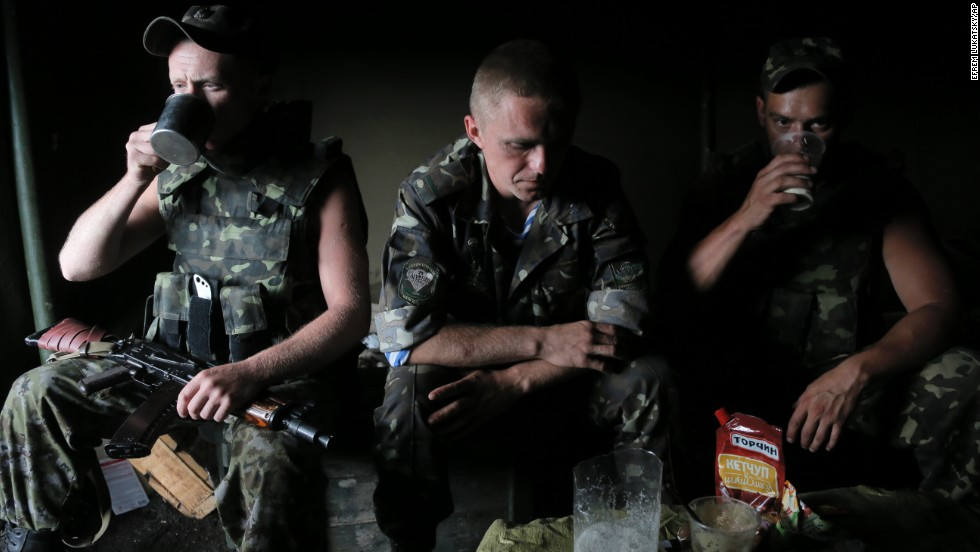 Ukrainian soldiers rest at a checkpoint outside Slovyansk on Thursday, May 29.