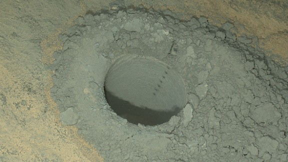 Curiosity took this nighttime photo of a hole it drilled to collect soil samples. NASA said this image combines eight exposures taken after dark.