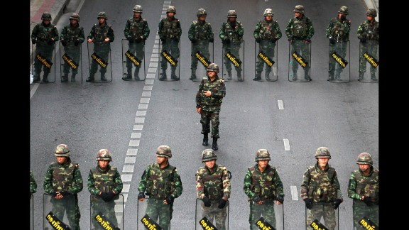 Thai soldiers guard a bus stop area to prevent an anti-coup demonstration in Bangkok on Thursday, May 29.