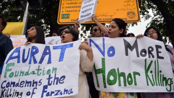 Pakistani human rights activists hold placards as they chant slogans during a protest in Islamabad on May 29, 2014 against the killing of pregnant woman Farzana Parveen was beaten to death with bricks by members of her own family for marrying a man of her own choice in Lahore. Pakistan