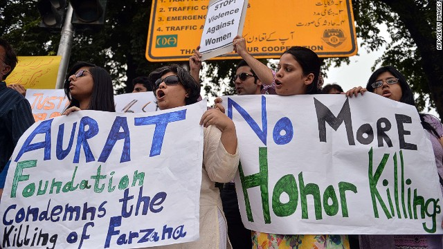 "Pakistani human rights activists hold placards as they chant slogans during a protest in Islamabad on May 29, 2014 against the killing of pregnant woman Farzana Parveen was beaten to death with bricks by members of her own family for marrying a man of her own choice in Lahore. Pakistan's prime minister demanded ""immediate action"" over the brutal murder of a pregnant woman who was bludgeoned to death with bricks outside a courthouse while police stood by. Farzana Parveen was attacked on May 27 outside the High Court building in the eastern city of Lahore by more than two dozen brick-wielding attackers, including her brother and father, for marrying against the wishes of her family. AFP PHOTO/Aamir QURESHIAAMIR QURESHI/AFP/Getty Images"
