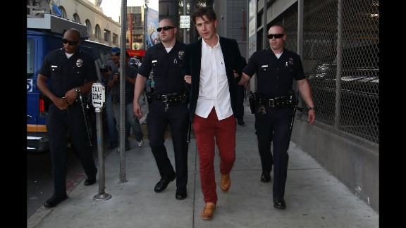 Brad Pitt became prankster Vitalii Sediuk's latest victim at the Maleficent Premiere in Los Angeles. The Sediuk was seen throwing the First punch. Brad Pitt looked angry as he answered the attack with multiple punches at Sediuk, who was arrested and taken away in hand-cuffs. Los Angeles, California - Wednesday May 28, 2014.