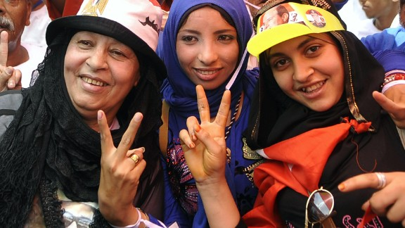 Egyptian supporters of  Abdel Fattah al-Sisi celebrate after Sisi scored a crushing presidential election triumph on May 30, 2014.