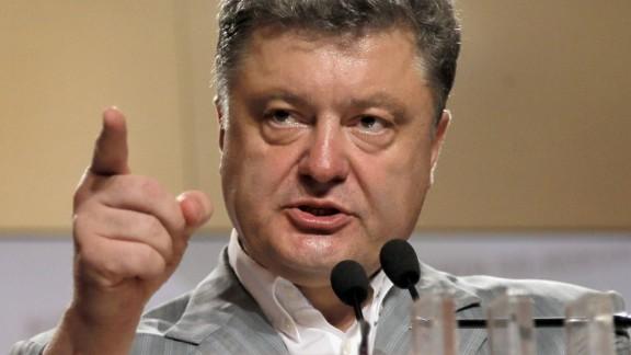 Ukrainian presidential candidate Petro Poroshenko gestures, during a press conference, in Kiev, Ukraine, Monday, May 26, 2014.