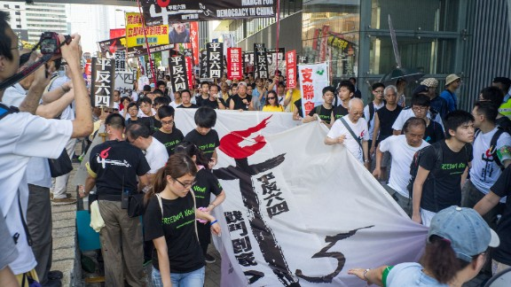 A team of activists carried a massive banner demanding Chinese leaders formally acknowledge what happened on June 4th, 1989